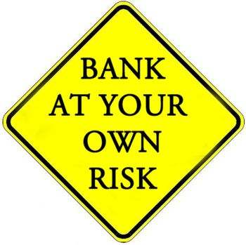 "Image: Warning sign ""bank at your own risk"""
