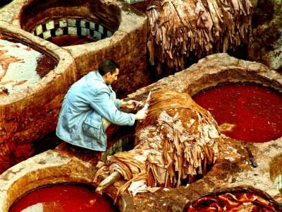 Image: man working in leather tannery furniture shops