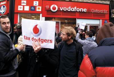 image: fair tax protestors vodaphone tax avoidance sign vidaphone tax dodgers