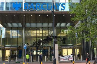 image: extinction rebellion barclays building fake oil protest