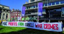 image: protesters with banner reading hsbc profits from israeli war crimes which led to hsbc divesting from israeli war crimes