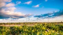 windfarm in a field with a blue cloudy sky ethical consumer