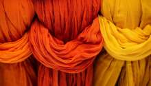 image: ethical cloth colourful dye fabrics in a row