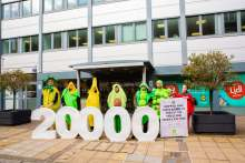image: oxfam human rights campaign aldi protest 20000 protesters dressed up as fruit and vegetables outside lidl