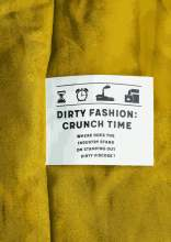 Clothing label with title of Dirty Fashion report