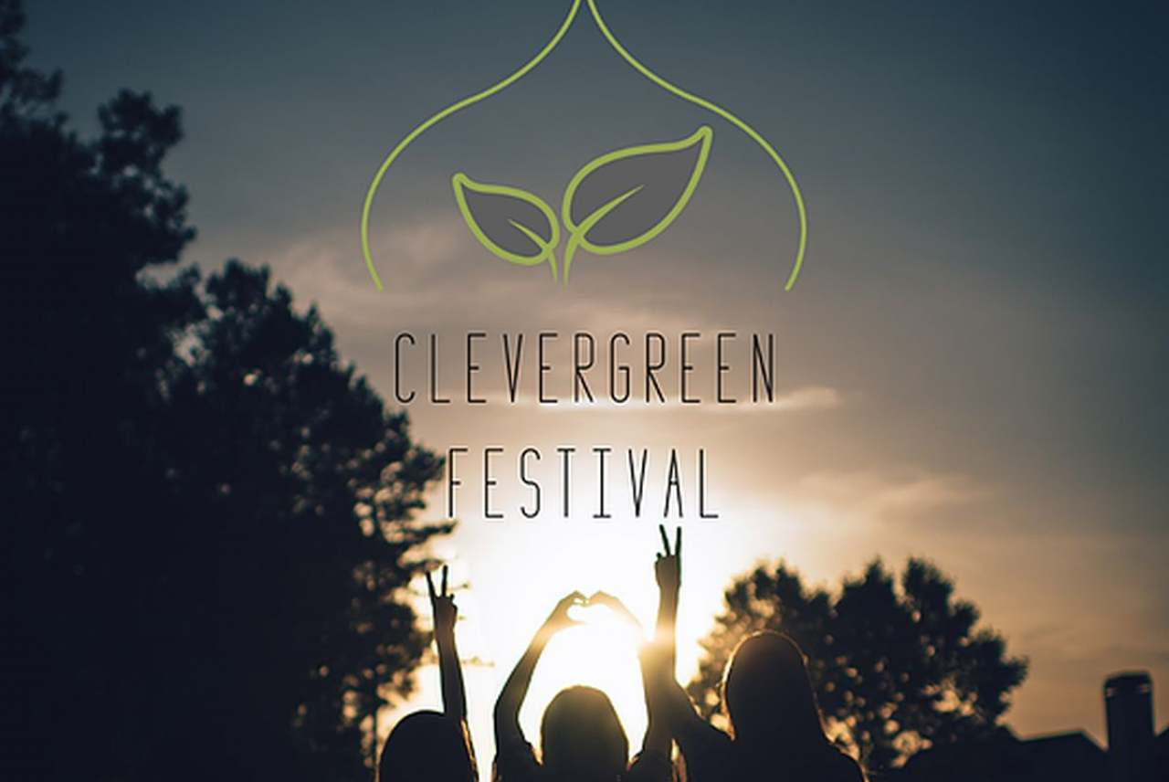 Image: clevergreen festival brighton girls silhouetted in the sun below the logo
