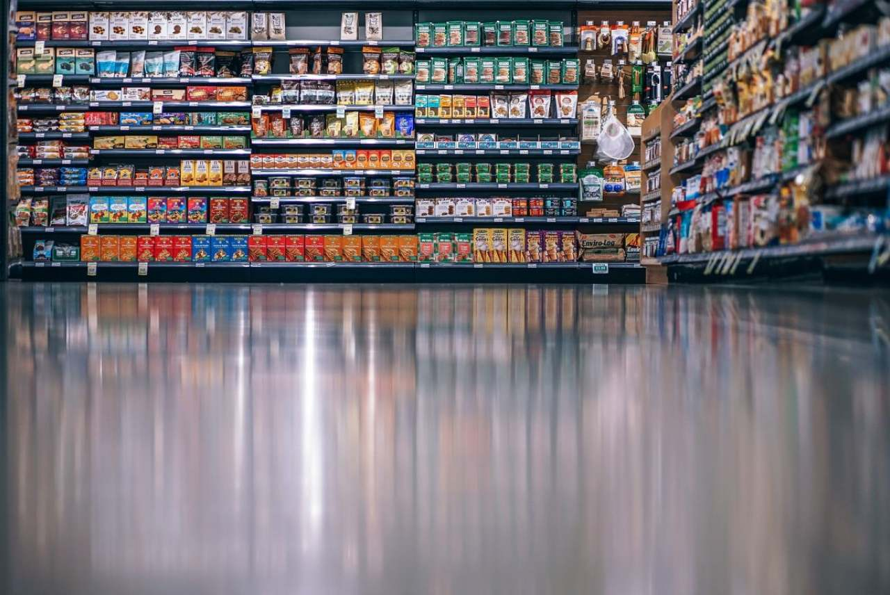Image: supermarket floor reflects masses of supermarket products
