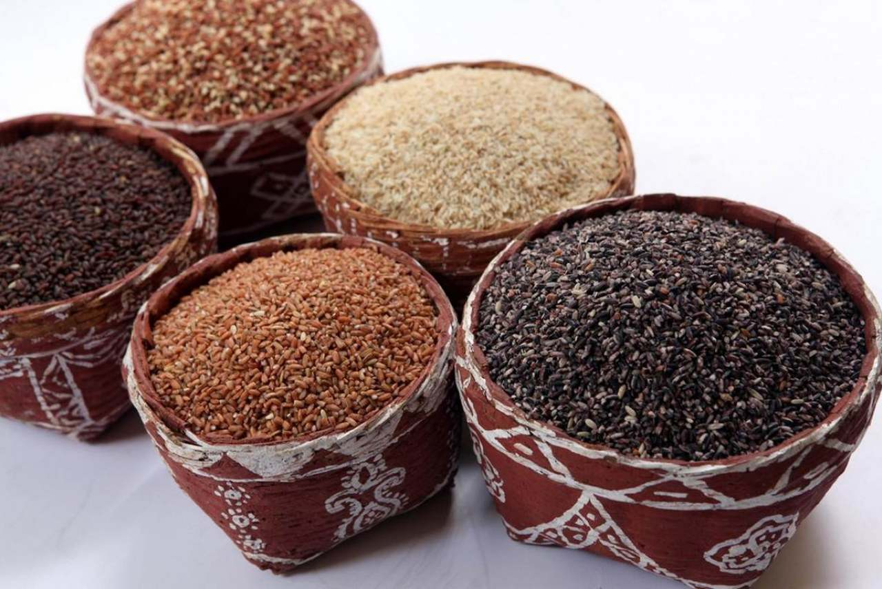 Image: different rices in traditionally decorated indian containers