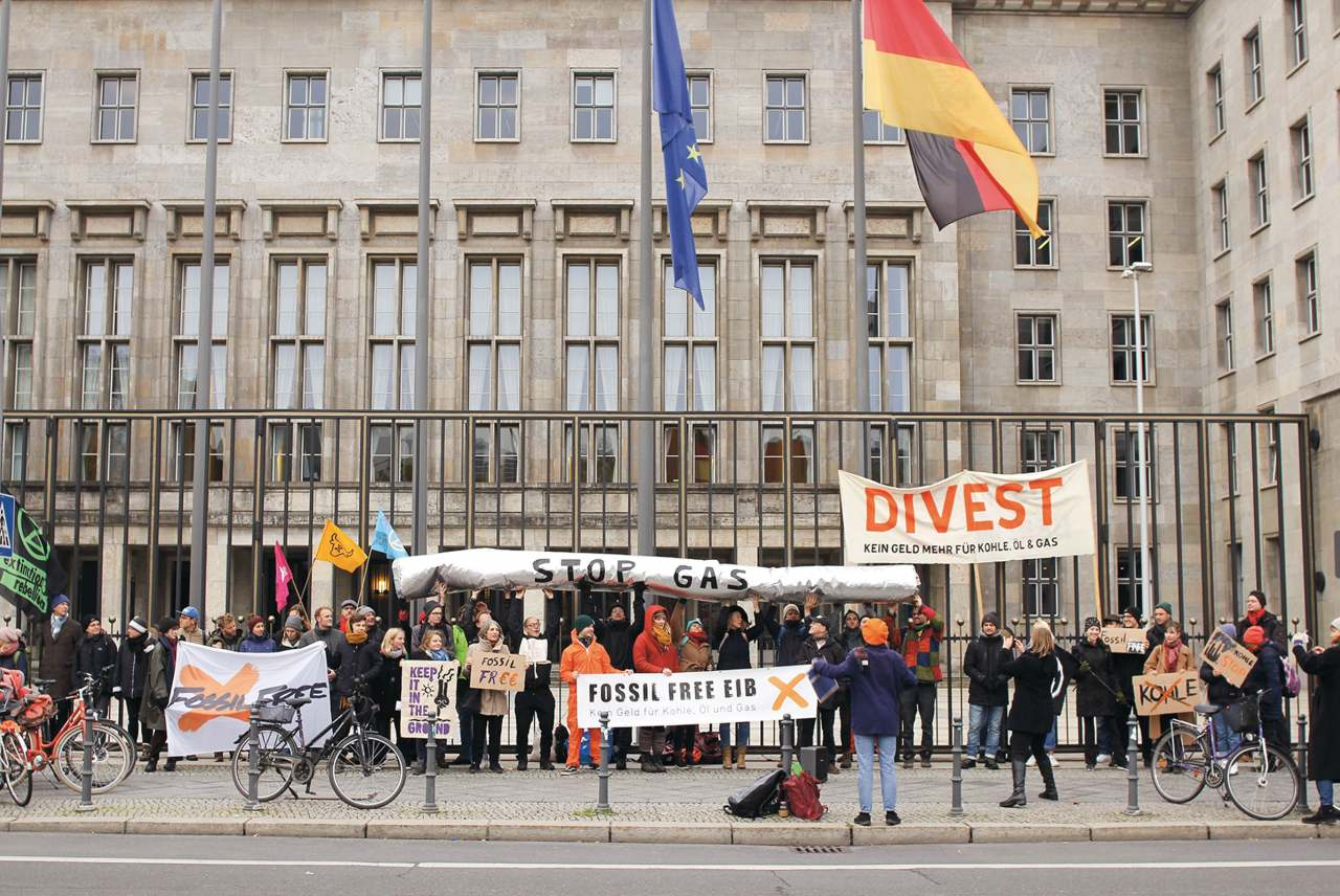 image: divest EIB berlin strike flags
