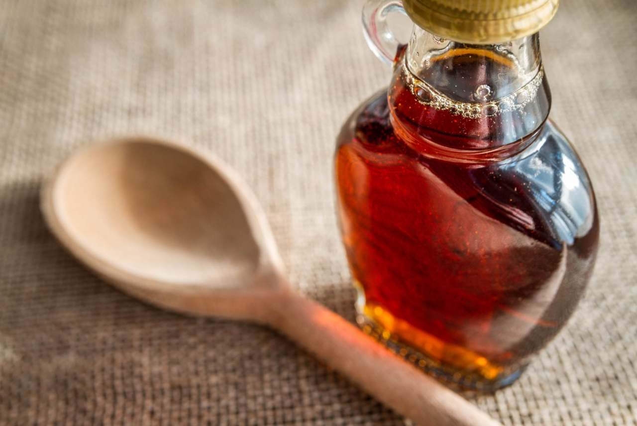 maple-syrup-glass-jar-wooden-spoon-cooking-honey-alternative