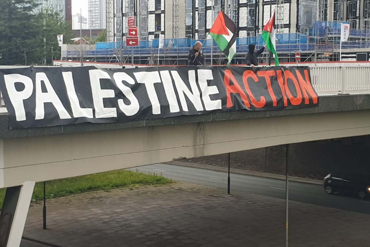 image: palestine action banner across a bridge in the UK