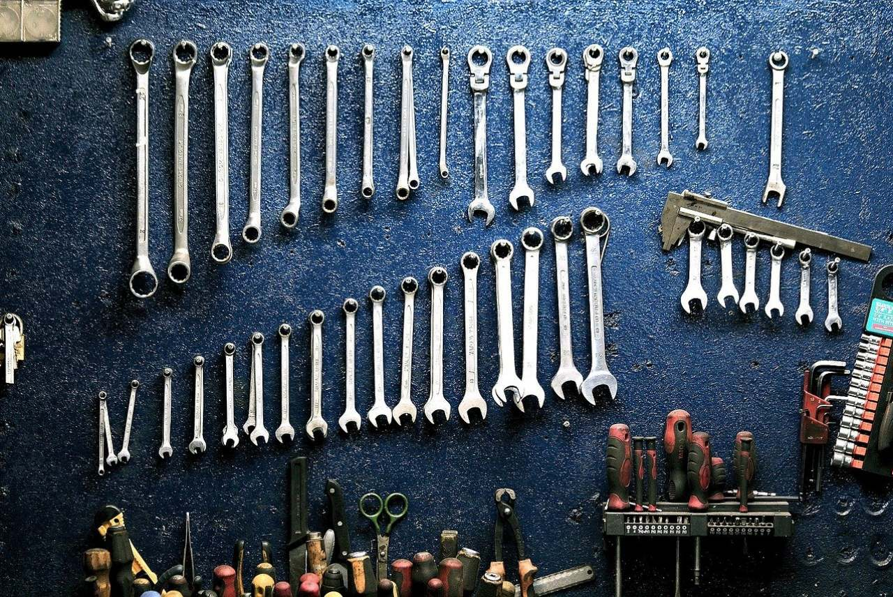 Tools and spanners hanging on wall