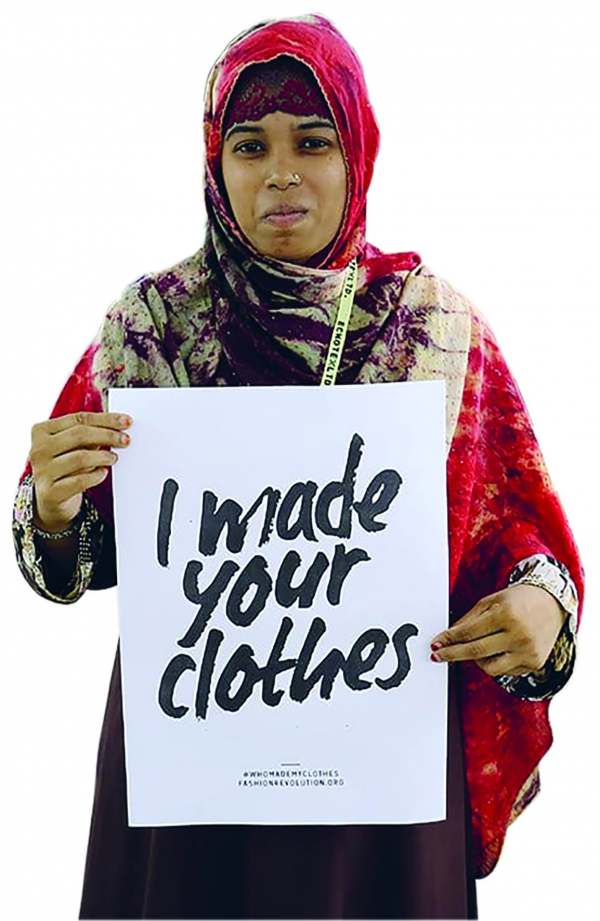 image: lady in sari with sign stating i made your clothes